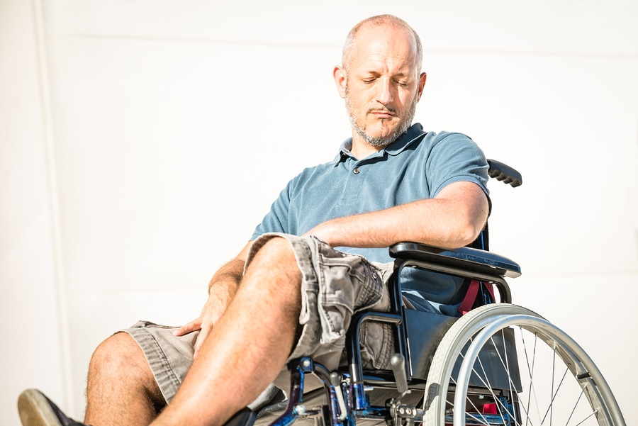 Invalier im Rollstuhl